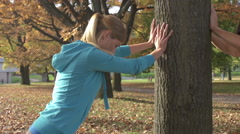 Attractive Young Athletic Woman Stretches Her Legs  Stock Footage