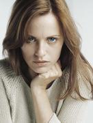 Woman glaring at camera, close-up Stock Photos