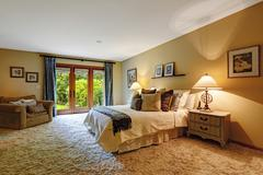 master bedroom interior with exit to backayrd. - stock photo