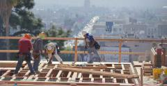 Construction workers working on high storeys apartment building site in LA Stock Footage