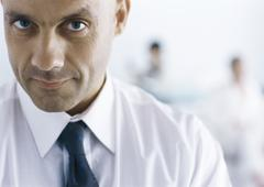 Businessman looking at camera with eyebrow raised - stock photo