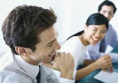 Businesspeople laughing together Stock Photos
