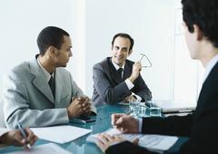 Business people sitting around table having meeting Stock Photos