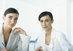 Two businesswomen looking at camera, head and shoulders Stock Photos