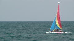 Colorful sailboat against gray skies. - stock footage