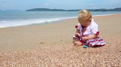 Girl in Ukrainian costume embroidery on beach Stock Footage