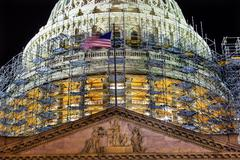 us capitol north side dome construction close up flag night stars washington  - stock photo