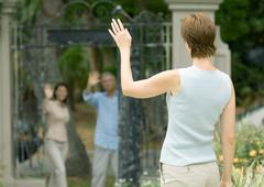 Woman waving to neighbors Stock Photos