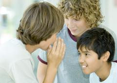 Preteen boys whispering Stock Photos