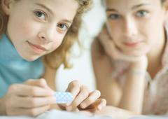 Preteen girls filing nails Stock Photos