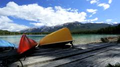 Canoes mountain lake endurance recreational endurance sport Canada - stock footage