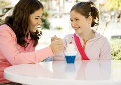 Two preteen girls sharing dessert Stock Photos