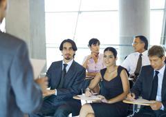 Executives sitting in seminar Stock Photos