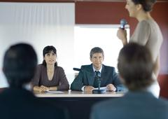 Woman speaking with microphone in conference room during seminar Stock Photos