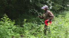 Man marking the demining area in forest. Stock Footage