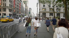 Midtown Manhattan Tourists Walking 5th Ave New York City NYC Tourism New Yorkers Stock Footage