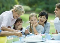 Family having outdoor birthday party Stock Photos