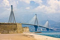 Suspension bridge crossing Corinth Gulf strait, Greece Stock Photos