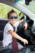 Cute driver  sits in car - stock photo