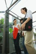 Friends in covered walkway, chatting, low angle view - stock photo