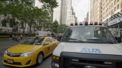 NYPD Police Vehicle Cops Car Van Taxi Cab Midtown Manhattan NYC New York City Stock Footage