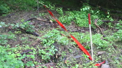 Area of demining marked with red tape. Stock Footage