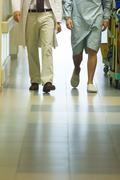 Male doctor walking with patient in hospital corridor, cropped view of legs Kuvituskuvat