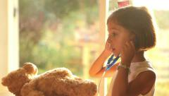 Role playing doctor ambition cute young girl with teddy bear Stock Footage