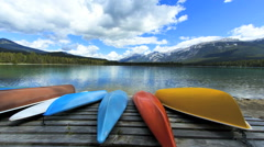 Stock Video Footage of Glacial Water Mountains Valley Travel Activity Canoe Sailing Leisure Time Lapse