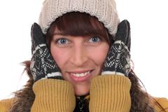 portrait of a young woman freezing in the cold in winter - stock photo