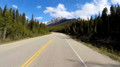 POV Driving Travel Tourism Location Remote Environment Snow Rock Glacial Valley - stock footage