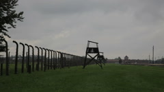 Watchtowers behind barbed wire Auschwitz Stock Footage