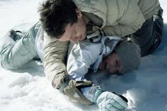 Young friends playfighting in snow Stock Photos