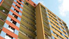 Modern building (apartments - flats) - balcony - windows - blue sky Stock Footage