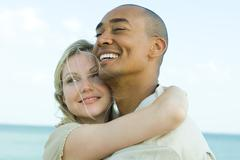 Couple embracing and smiling outdoors, close-up Stock Photos