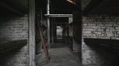Auschwitz Birkenau bunk beds in barrack Stock Footage