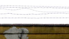 Barbed fence - stone wall peeled Stock Footage