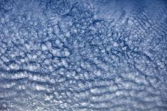 Altocumulus middle-altitude cloud in stratocumuliform - nature background Stock Photos