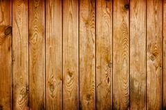 Wall covered with brown grunge wooden boards - natural background Stock Photos