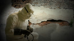 Ebola doctor checking someone laying on the ground Stock Footage