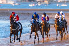 horse race on sanlucar of barrameda, spain - stock photo
