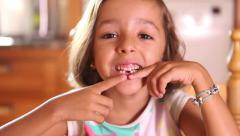 Beautiful little girl showing missing teeth Stock Footage