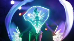 Dancer in glowing clothes on stage Stock Footage