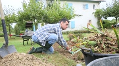 Gardener cleaning land to plant new flowers Stock Footage