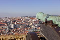 Sao jorge (st. george) castle in lisbon, portugal. old bronze cannon and a vi Stock Photos