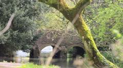 Bridge over river in rural England - stock footage