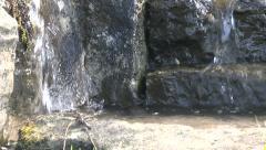 Waterfall Trickling Down Between Rocks Stock Footage