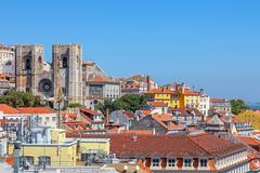 lisbon cathedral or se de lisboa and alfama rooftops, lisbon, portugal - stock photo