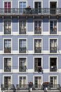 Windows of an old typical building in lower graca district. lisbon, portugal. Stock Photos