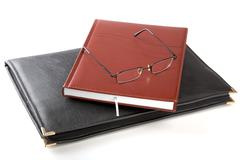 Folder for papers an organizer and glasses Stock Photos